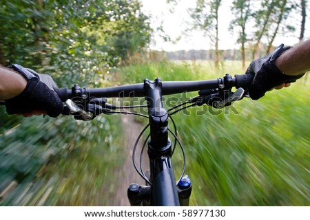 Bicycle rider on mountain bike, motion blur - stock photo