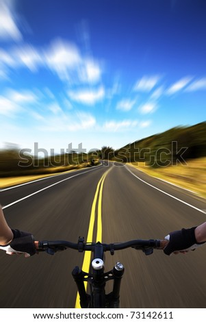 Bicycle rider with high speed view on the road - stock photo