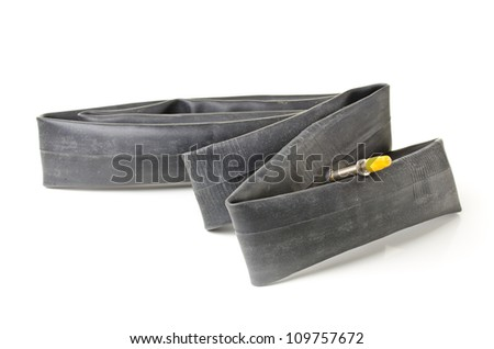 Bicycle rubber inner tube over white background - stock photo
