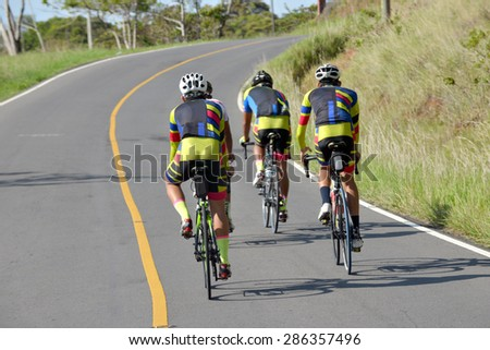 Bicycle runners on a country road in the heart of Panama - stock photo
