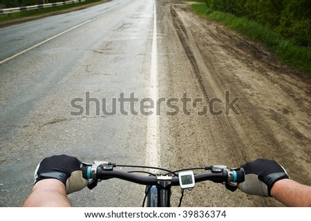 Bicycle running along the road - stock photo