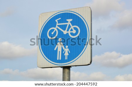 bicycle sign and blue sky - stock photo