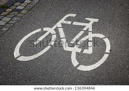 Bicycle sign on the road in Lubeck, Germany - stock photo