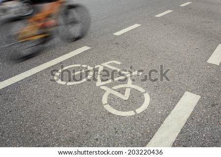 Bicycle sign or icon and movement  of cyclist in the park - stock photo