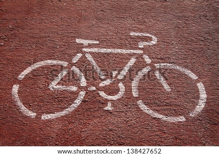 Bicycle sign over asphalt in red and white - stock photo