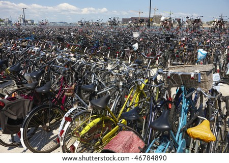 Bicycle storage at Central train station in Amsterdam, Holland - stock photo