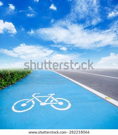 bicycle symbol lane on blue sky background. - stock photo