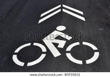 Bicycle symbol on asphalt street - stock photo