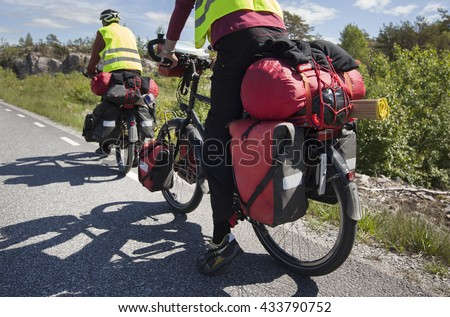 Bicycle Touring on the road - stock photo