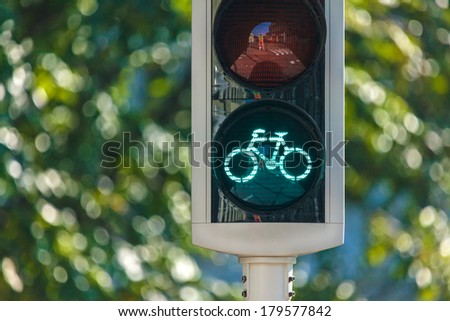 Bicycle traffic light in The Netherlands with trees in the background - stock photo