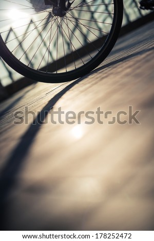 Bicycle wheel in the street - stock photo