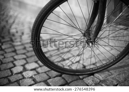 Bicycle Wheel on a Cobbled Street in Copenhagen - stock photo