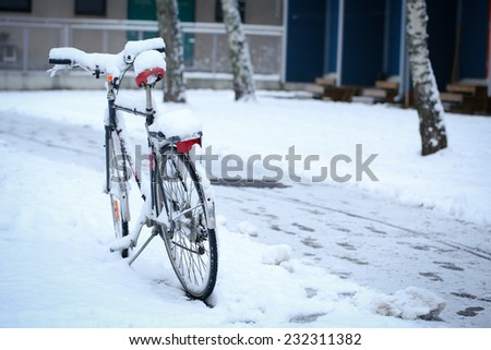 Bicycle with a thick snow in a winter day - stock photo