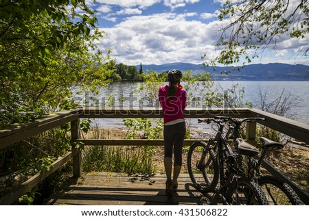 Bicycler at the Lakeshore - stock photo