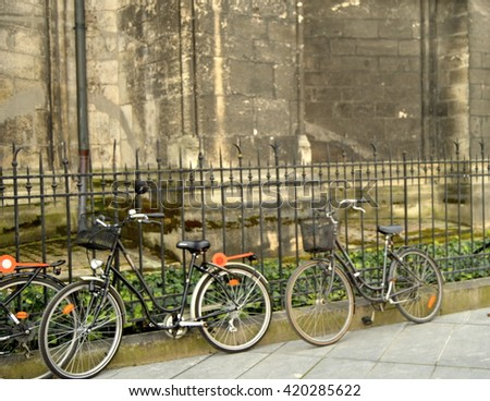 Bicycles Against a Fence in Bordeaux, France
