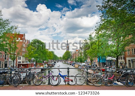 Bicycles on a bridge over the canals of Amsterdam, Netherlands - stock photo