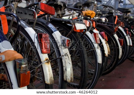 Bicycles parked in a row in Amsterdam, Holland - stock photo