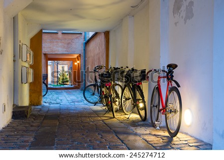 Bicycles parked in the arch - stock photo