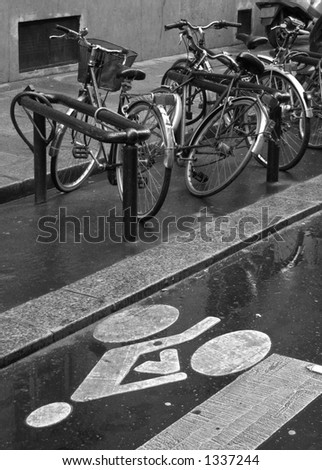 Bicycles parked near bicycle street symbol in Paris with - stock photo