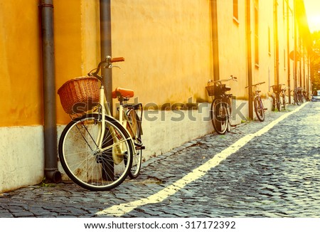 Bicycles parked on the street in Rome, Italy - stock photo