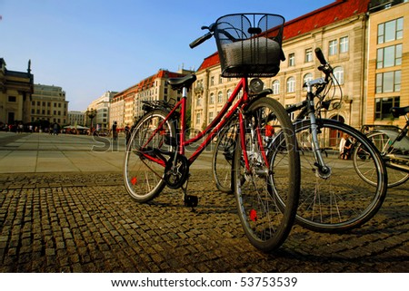 Bicycles standing on a street in Berlin - stock photo