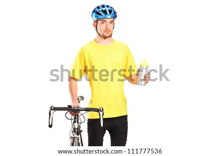 Bicyclist posing next to a bicycle and holding a bottle isolated on white background