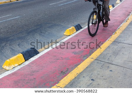 bicyclist red bike path in the modern city - stock photo