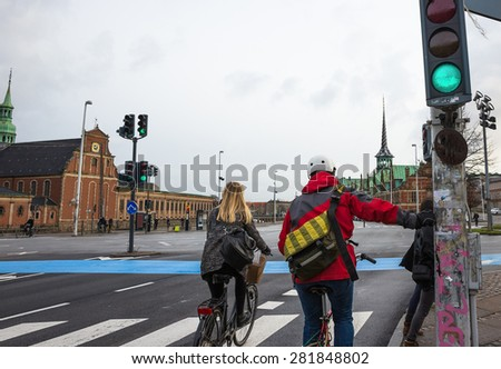 Bicyclists on road in Copenhagen - stock photo