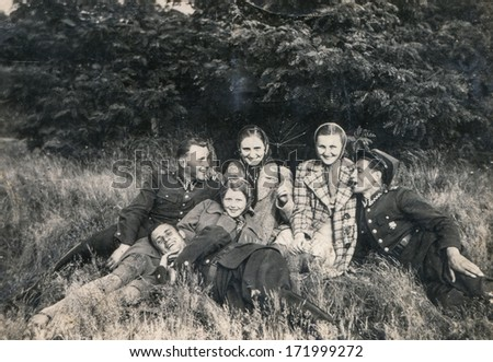 BIELSKO, POLAND, JULY 1939 - vintage photo of young soldiers and their girlfriends outdoor - stock photo