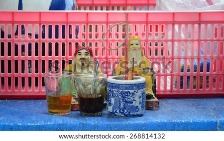 BIEN HOA, VIETNAM - APR 6, 2015: The altar of Tu Di Gong, a Chinese earth god worshipped by Chinese folk religion worshippers and Taoists in Vietnam. - stock photo