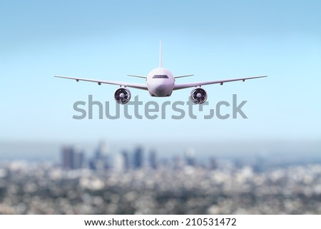 big airliner flying over the city