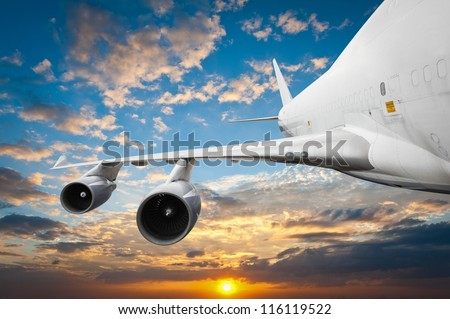 Big airliner in the sky - stock photo