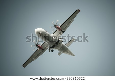 Big airplane in the sky - Passenger Airliner / aircraft  - stock photo