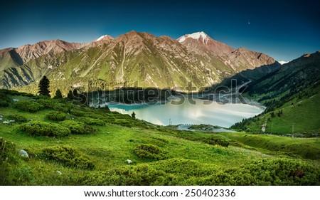 Big Almaty Lake in the mountains of Zaili Alatay, Kazakhstan, Central Asia - stock photo