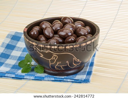 Big Almond in chocolate on the bowl - stock photo