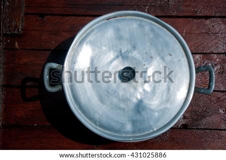 big aluminum pot with lid top view - stock photo