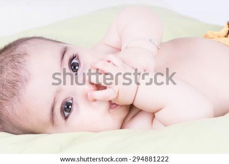 Big and bright eyes of baby toddler close up shot - stock photo