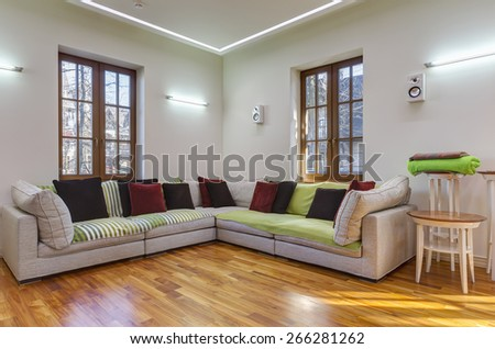 Big and comfortable living room with sofa in luxury mansion - stock photo