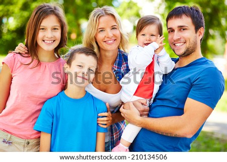 Big and happy family having outdoor rest - stock photo