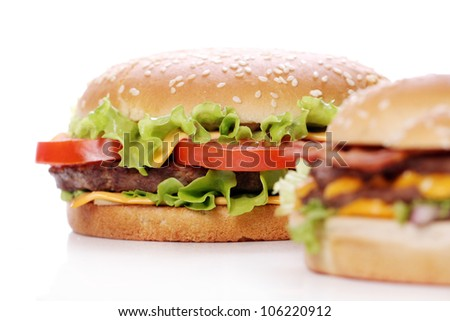 Big and tasty burgers over white background - stock photo
