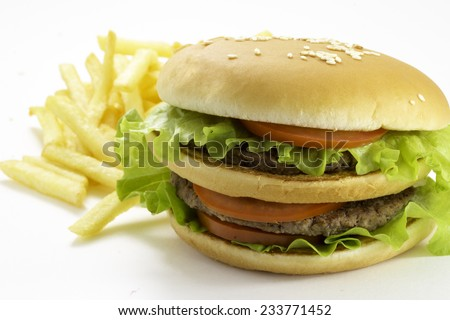Big and tasty hamburger and fried potatoes isolated on white background - stock photo