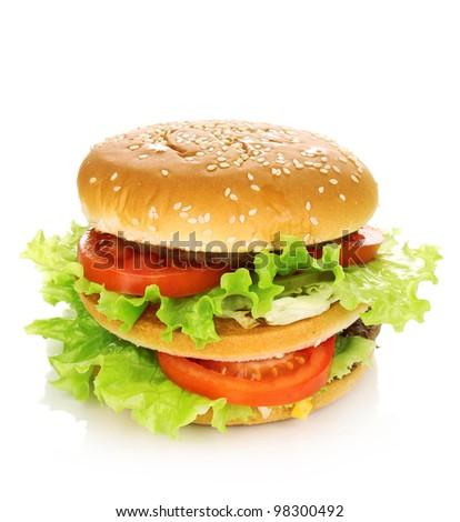 Big and tasty hamburger isolated on white - stock photo