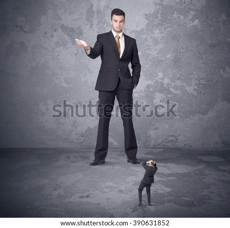 Big angry boss looking at tiny coworker concept on background - stock photo