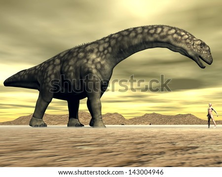 Big argentinosaurus dinosair face to face with a small human in the desert - stock photo