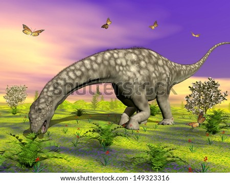 Big argentinosaurus dinosaur eating peacefully small plants, surrounded with butterflies and flowers by colorful sunset - stock photo