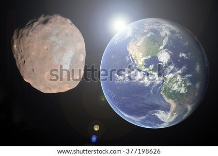 "Big Asteroid Closing to the Earth Planet. Apocalypse Concept. ""Elements of this image furnished by NASA "" - stock photo"