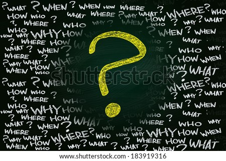 Big basic questions concept, written with Chalk on Blackboard - stock photo