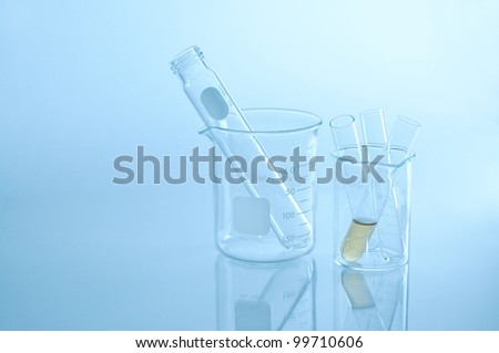 Big beaker and small beaker for chemical science use in laboratory.