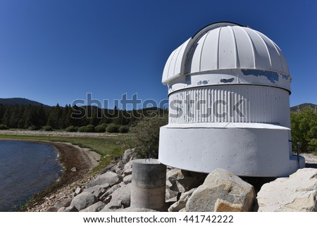 Big Bear Lake, California, June 16, 2016 : The Big Bear Solar Observatory Ash Dome with the lake level down 14 feet from normal. - stock photo