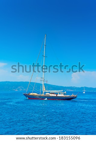 big beautiful sailing yacht in the port of Hydra island in Greece